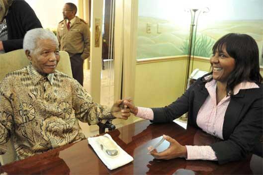 Former South African President Nelson Mandela with granddaughter Ndileka Mandela before casting his vote