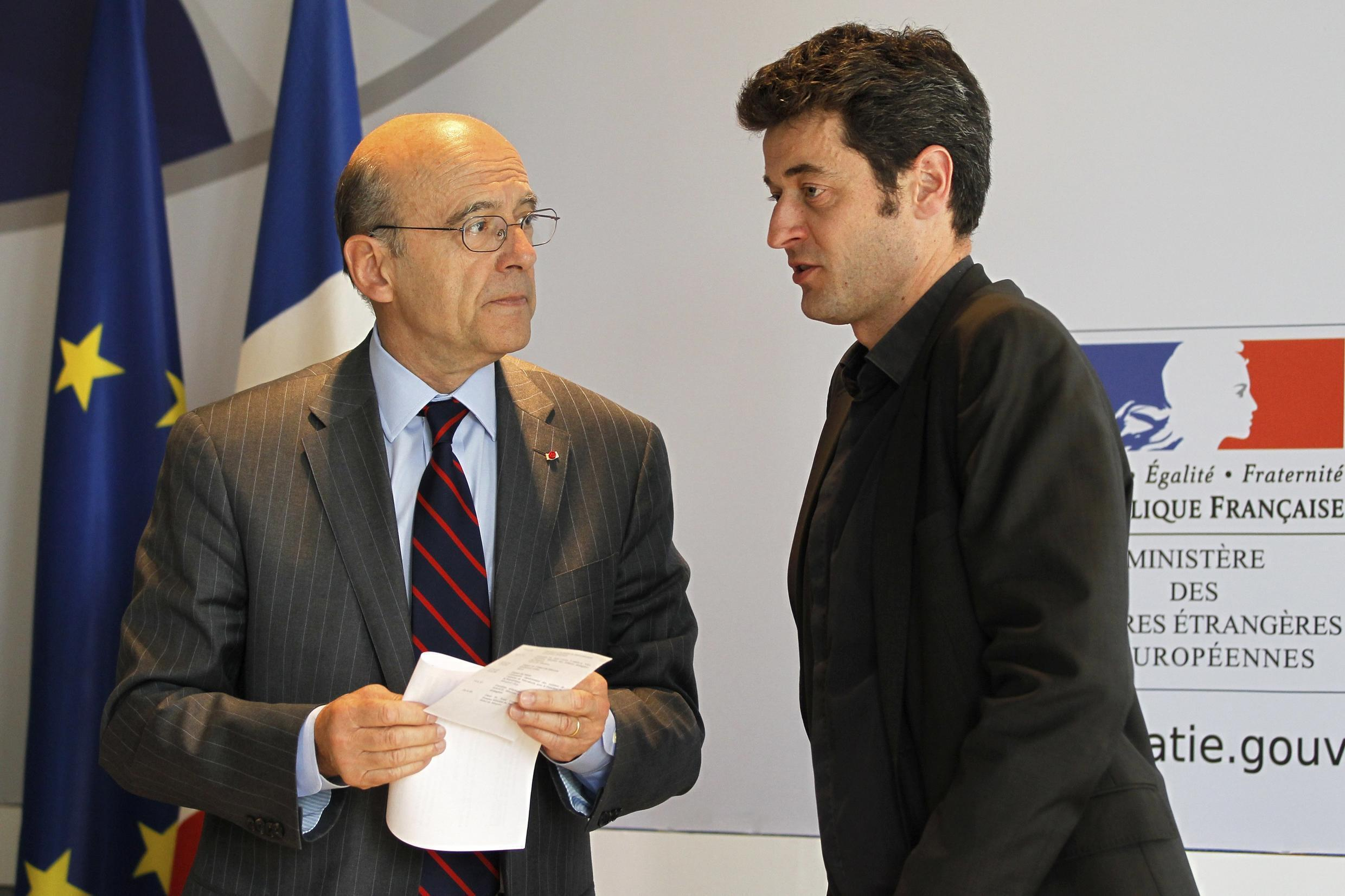 French Foreign Minister Alain Juppé with RSF's Jean-Francois Julliard after a news conference in Paris Tuesday