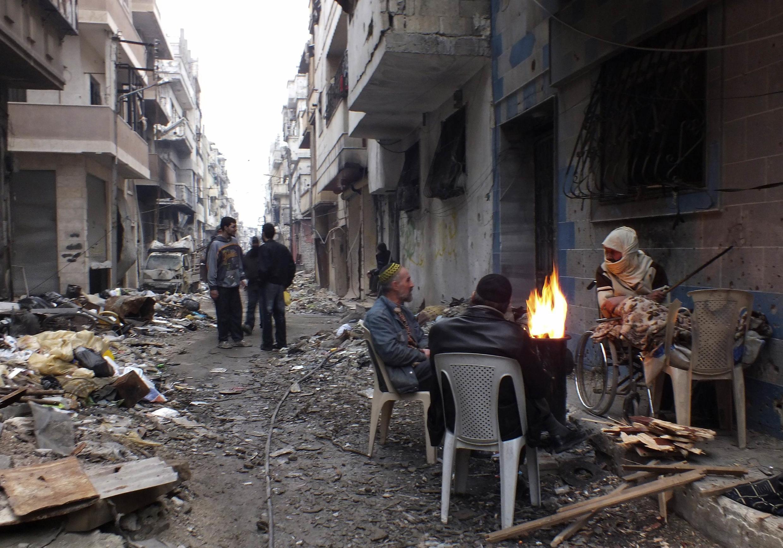 L'aide humanitaire va permettre de fournir une aide vitale à quelque 2 500 civils bloqués par les combats. Homs, le 27 janvier 2014.