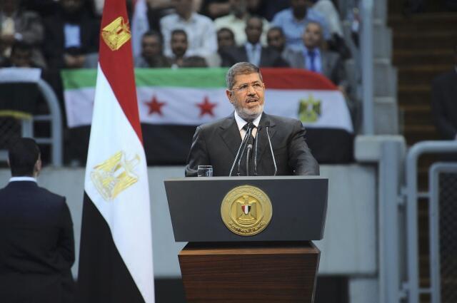 Tổng thống Ai Cập Mohamed Morsi phát biểu tại hội nghị đoàn kết Syria, do phe Huynh đệ Hồi giáo tổ chức tại Cairo hôm 15/06/2013.