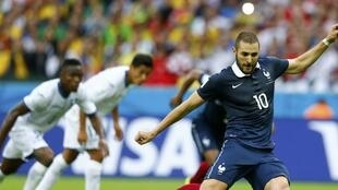 France's Karim Benzema takes a penalty and scores a goal during his match against Honduras