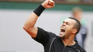 Jo-Wilfried Tsonga of France celebrates after beating Tomas Berdych of the Czech Republic during their men's singles match at the French Open at Roland Garros stadium in Paris, France, May 31, 2015