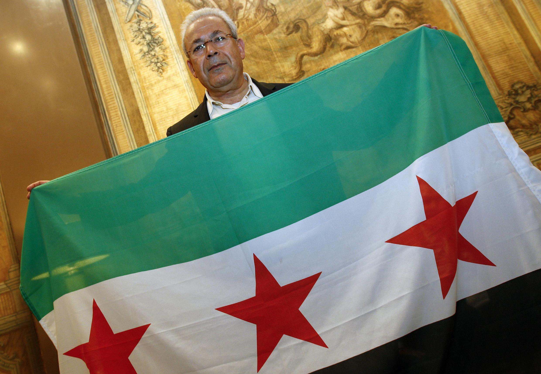 Líder do Conselho Nacional Sírio, Burhan Ghalioun, em reunião com dissidentes em Roma.