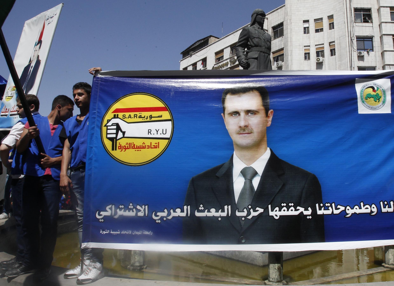 Wafuasi wa rais Bashar el Assad baada ya kutangza kugombea kwake kwenye kiti cha urais, aprili 28 mwaka 2014.