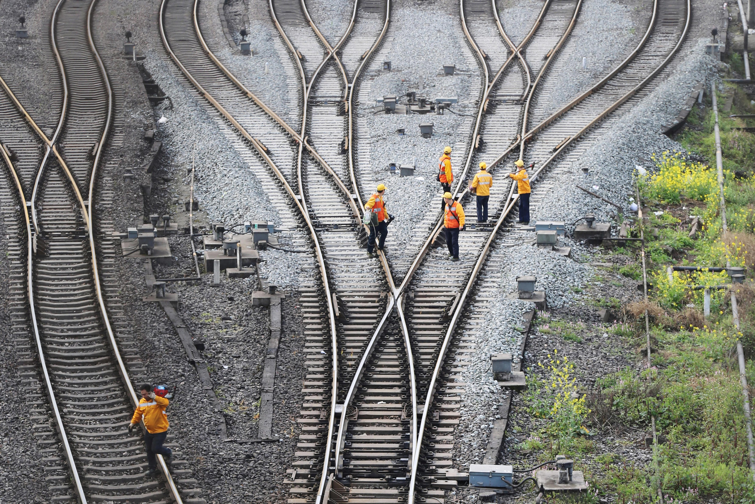 Workers inspect railway tracks, which serve as a part of the Belt and Road freight rail route linking Chongqing to Duisburg, at Dazhou railway station in Sichuan province, China March 14, 2019.