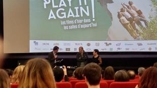 Opening of the film classics festival, Play It Again Sam, François Thirriot (L), film director Cédric Klapisch (C) and cinema director Isabelle Gibbal-Hardy (R)at the Grand Action art-house cinema in Paris
