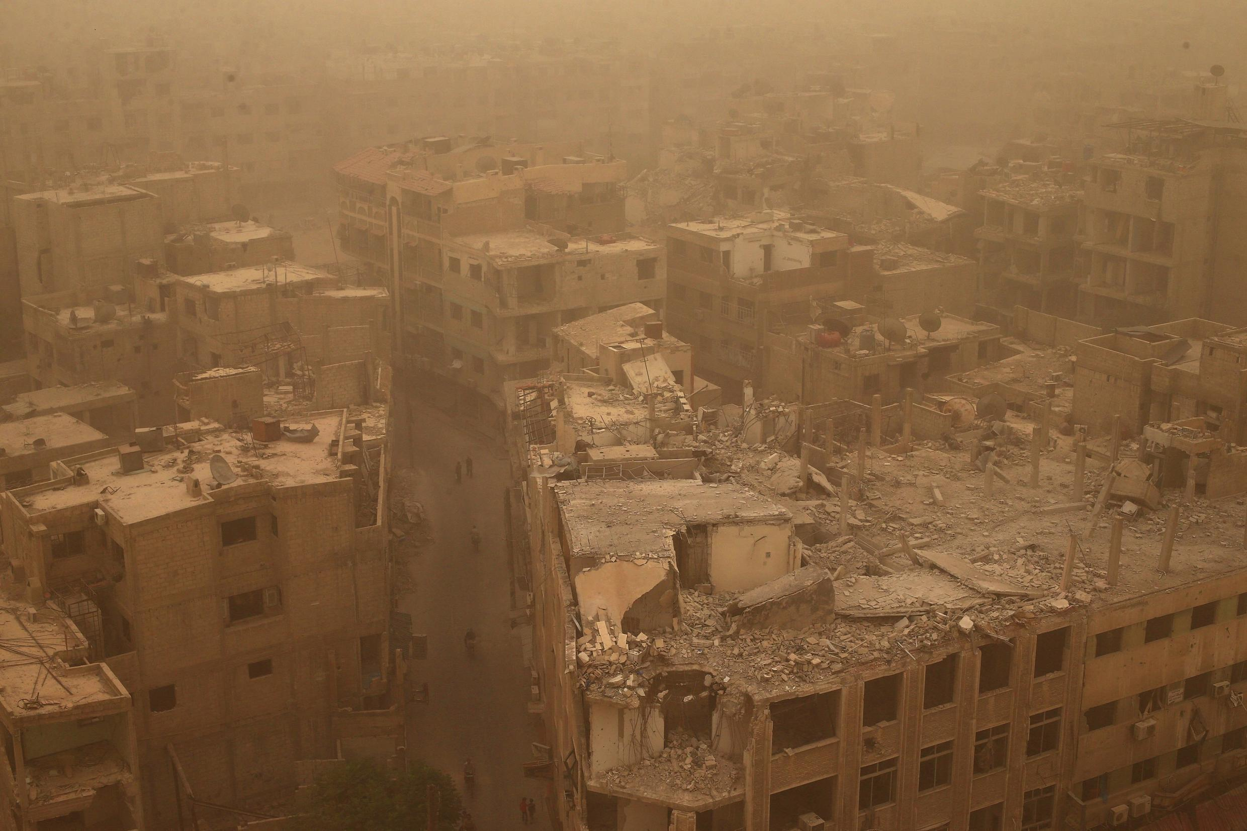 Damaged buildings are pictured during a sandstorm in the Douma neighbourhood of Damascus, Syria, 7 September 2015.