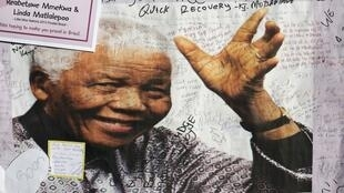 A poster of Nelson Mandela is filled with get well messages outside the Medi-Clinic Heart Hospital in Pretoria, 3 July, 2013