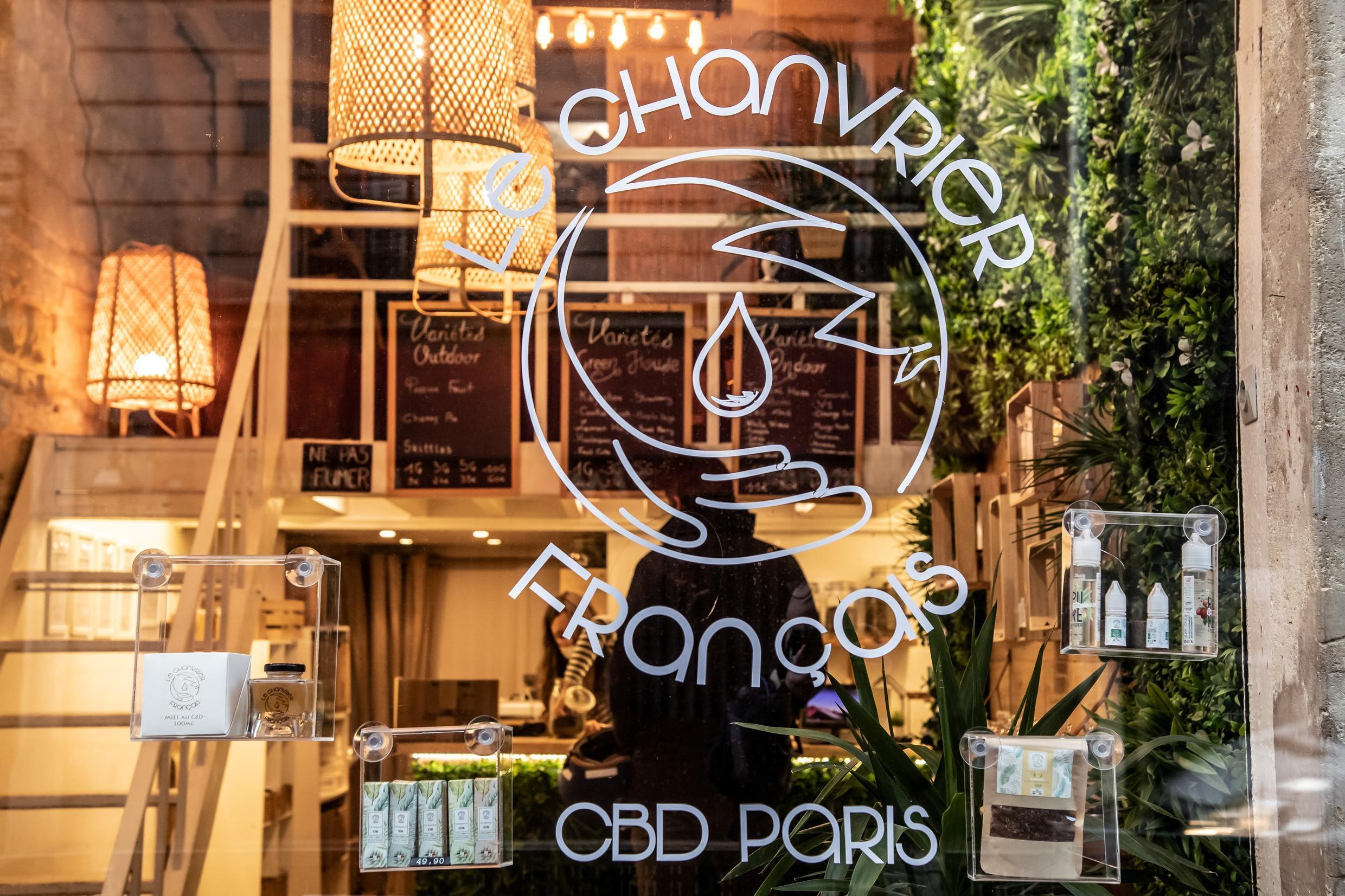 """A picture shows the front window of """"Le Chanvrier Francais"""" CBD (cannabidiol) shop in Paris on February 2, 2021."""