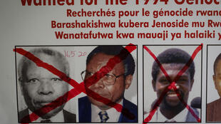 Wanted posted in the bureau for the search for fugitives of the Rwandan genocide in Kigali, 22 May 2020 following the arrest of Félicien Kabuga in France