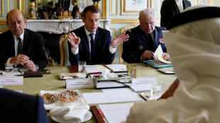 French President Emmanuel Macron (C), French Foreign Minister Jean-Yves Le Drian (L) and Abu Dhabi's Crown Prince Sheikh Mohammed bin Zayed al-Nahyan (R) attend a meeting about Qatar crisis at the Elysee Place in Paris, France, June 21, 2017.