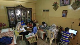 000_1Q416I_Khartoum_Soudan_famille_école_éducation_maison_coronavirus
