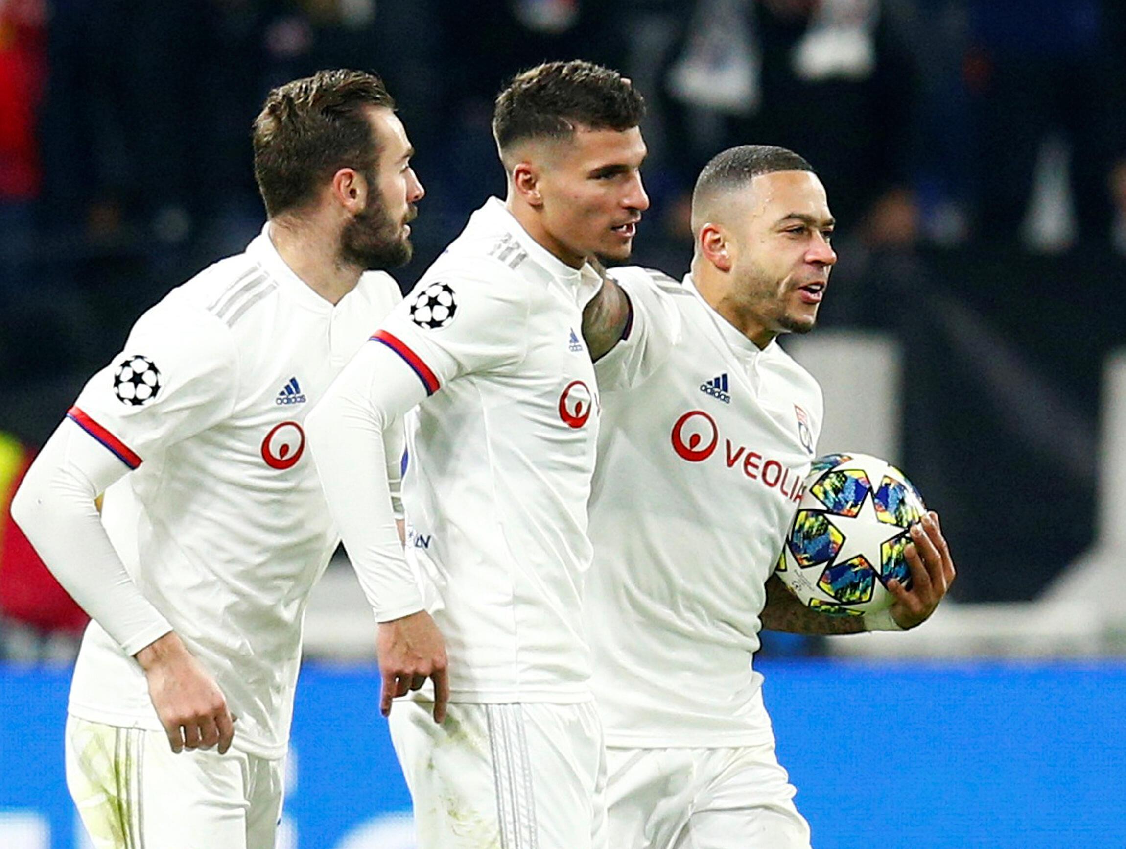Lucas Tousart, Houssem Aouar et Memphis Depay, joueurs de l'OL, sont qualifiés pour les huitièmes de finale de la Ligue des champions.