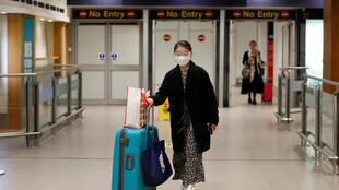 A passenger comes through the arrival terminal at Manchester Airport as Britain starts its Covid-19 quarantine measures on 8 June, 2020.