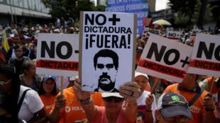 Manifestantes en la marcha convocada por la oposición venezolana. Caracas, 1ro de abril de 2017.