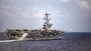 The USS Theodore Roosevelt aircraft carrier is in dock in Guam after an outbreak of Covid-19 infected at least 114 crew members