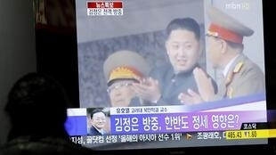 លោក Kim Jong-Un ជាកូនប្រុសរបស់មេដឹកនាំកូរ៉េខាងជើង,រូបថតនៅឱកាសលេចបង្ហាញខ្លួនជាសាធារណៈដ៏កម្រមួយតាមកញ្ចក់ទូរទស្សន៍រដ្ឋ។