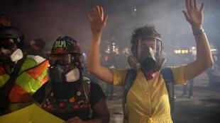 2020-07-26T063713Z_385540358_RC2U0I9MSRYI_RTRMADP_3_GLOBAL-RACE-PROTESTS-PORTLAND