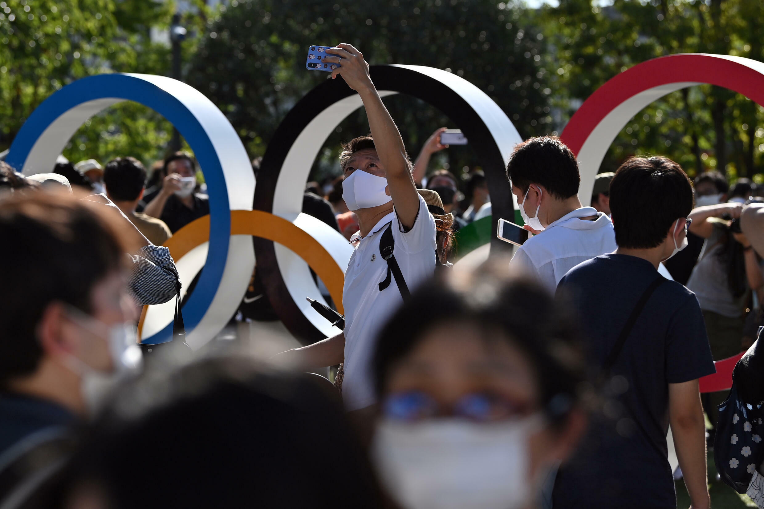 Hundreds of people gathered at the Olympic Stadium before the opening ceremony in Tokyo