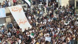 Demonstrators protest against Syria's President Bashar al-Assad near Homs
