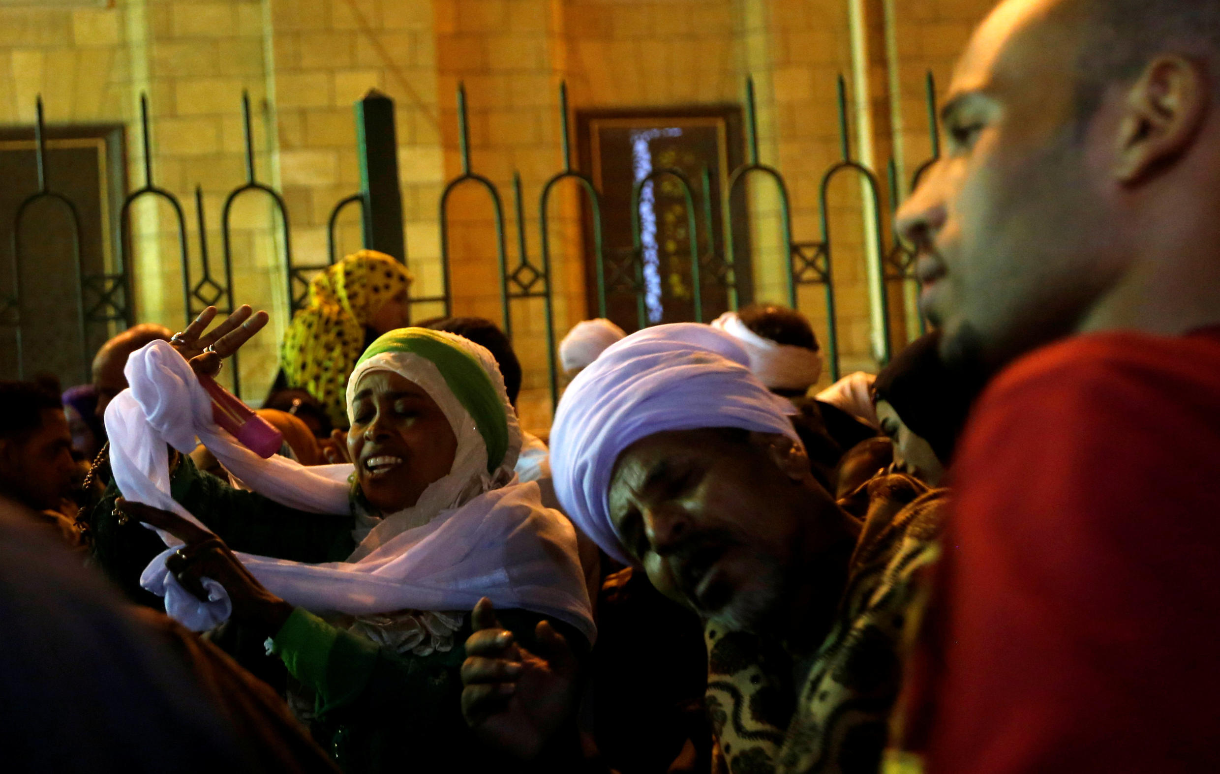 """Egyptian Sufi Muslims practice ritualized Zikr (invocation) to celebrate """"Mawlid al-Nabawi"""" or the birth of Prophet Mohammad outside the Al-Hussein mosque in old Cairo, Egypt, December 1, 2017."""