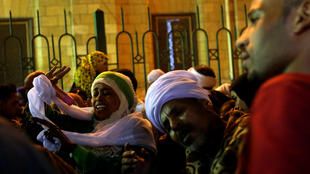 "Egyptian Sufi Muslims practice ritualized Zikr (invocation) to celebrate ""Mawlid al-Nabawi"" or the birth of Prophet Mohammad outside the Al-Hussein mosque in old Cairo, Egypt, December 1, 2017."
