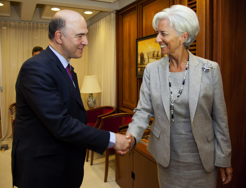 O ministro da Economia da França, Pierre Moscovici, e a diretora-gerente do FMI, Christine Lagarde, em encontro em Washington.