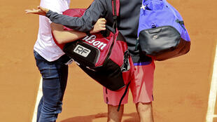 Roger Federer appeals to security after a spectator tries to take a selfie on court after his win