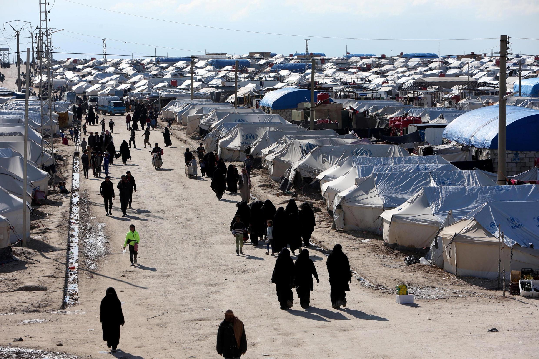 FILE PHOTO: FILE PHOTO: FILE PHOTO: Women walk through al-Hol displacement camp in Hasaka governorate, Syria April 1, 2019.