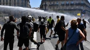 During a 'Yellow Vest' anti-government demonstration in Montpellier, France, police dispersed the crowd with water cannons. 8 June, 2019