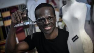 African first: Cameroon-born fashion designer Imane Ayissi at work in his Paris studio