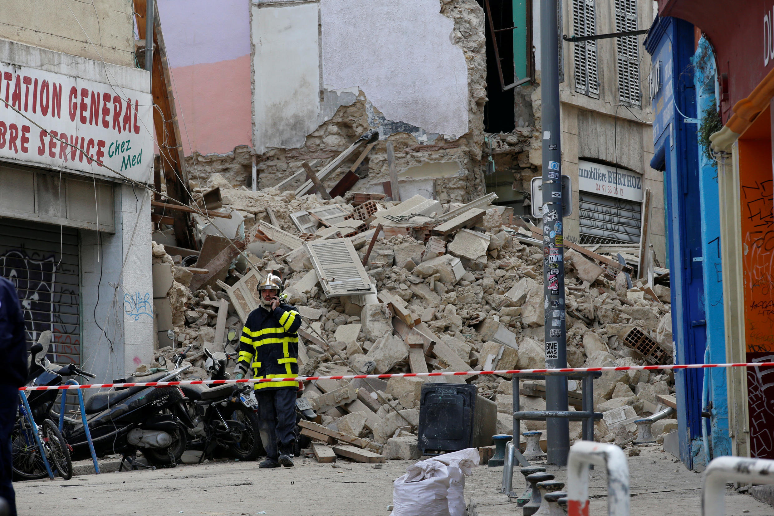 A rescue worker at the site of the building collapse in central Marseille