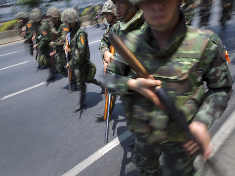 Thai troops charging towards Red Shirt protestors in Bangkok