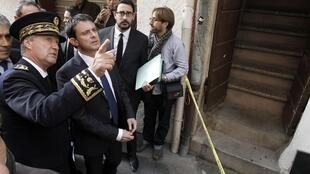 French Interior Minister Manuel Valls visits the scene of a previous murder