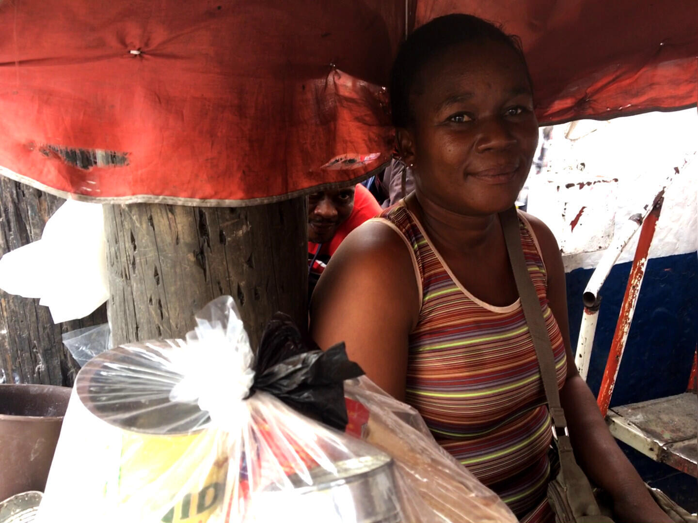 Market trader Cynthia Lloyd is worried less foreign aid money is being spent in Liberia.
