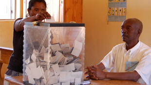 A woman casts her vote on a new draft constitution in Antananarivo
