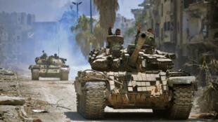 Vikosi vya serikali ya Syria vikiendesha mashambulizi dhidi ya ngome za wapiganaji wa IS katika wilaya ya Hajar al-Aswad, Mei 14, 2018.