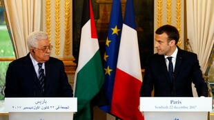 French President Emmanuel Macron and Palestinian President Mahmoud Abbas deliver a press statement after a meeting at the Elysee Palace in Paris on 22 December, 2017.