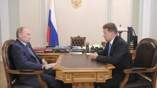 Russian Prime Minister Vladimir Putin meets with Gazprom CEO Alexei Miller
