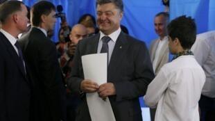 Кандидат в президенты Украины Петр Порошенко 25 мая 2014.