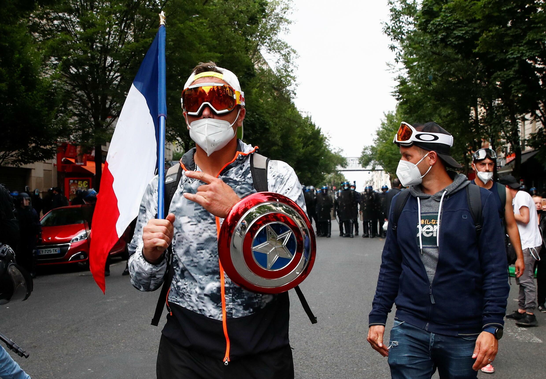 2021-07-14T161021Z_1225759099_RC2GKO9ELODQ_RTRMADP_3_HEALTH-CORONAVIRUS-FRANCE-PROTEST