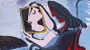 """O óleo sobre tela """"Femme au Miroir"""", de Pablo Picasso (1959), mostra a relação da mulher com seu rosto imaginário refletido no espelho."""