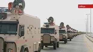 Saudi Arabian troops cross the causeway leading to Bahrain in this still image taken from video on 14 March 2011.