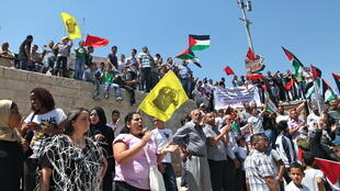Palestinian protestors gathered next to the Old City's Damascus Gate before marching through East Jerusalem, 11 May, 2012