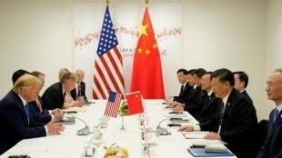 Le président américain, Donald Trump, et le président chinois lors de leur rencontre bilatérale, le 29 juin, à Osaka, à l'occasion du G20.