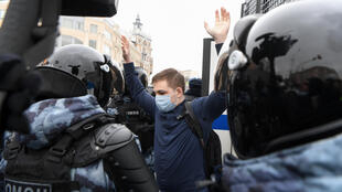 Riot police detain a man during a rally in support of jailed opposition leader Alexei Navalny in Moscow