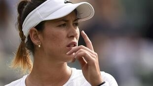 Garbine Muguruza says she has become a target after her victory at the French Open in Paris.