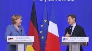 Angela Merkel and French President Nicolas Sarkozy at the Eurozone summit this weekend