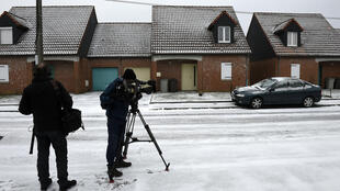 A TV crew outside Scala's house after his arrest