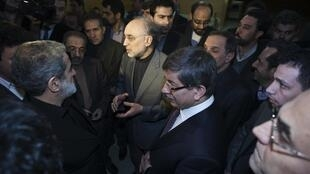 Iran's Foreign Minister Ali Akbar Salehi (C) speaks with the media